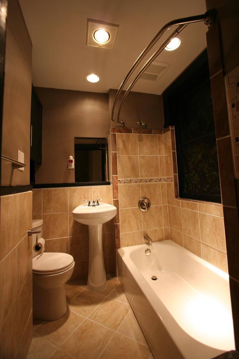 BATHROOM WITH EARTH TONE TILE, HALOGEN LIGHTING, HEAT LAMPS, CURVED SHOWER  ROD, BRUSHD NICKEL FIXTURES